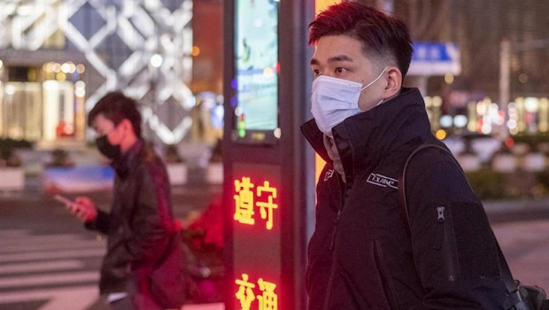 ep february 10 2020 shanghai china - two men protective masks wait at a pedestrian crossing on west