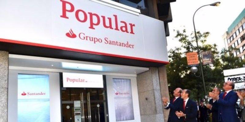 ep oficina de banco popular con el rotulo de grupo santander