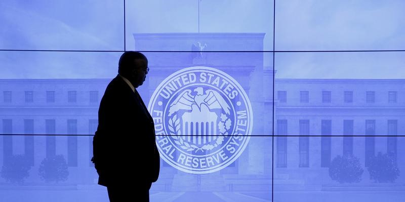 a-guard-walks-in-front-of-a-federal-reserve-image-before-press-conference-in-washington